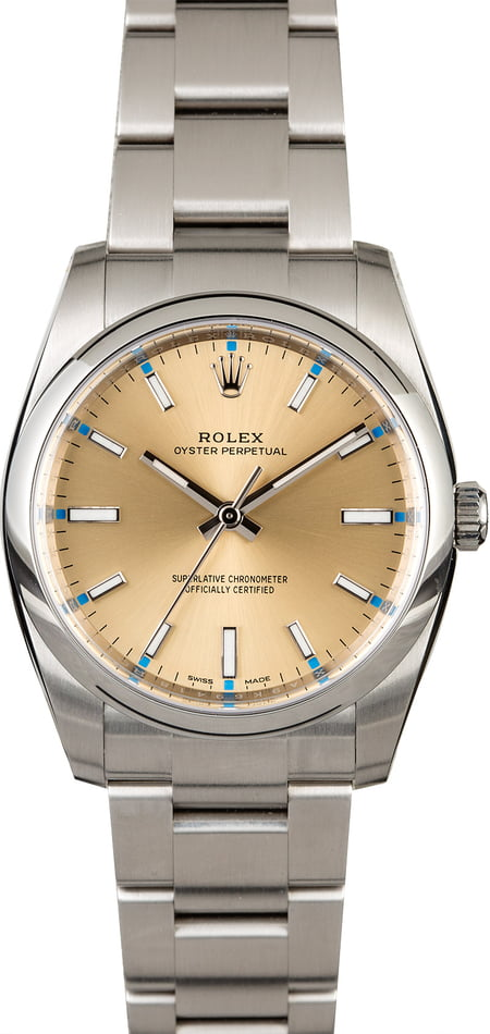 Rolex Oyster Perpetual 114200 Champagne Dial