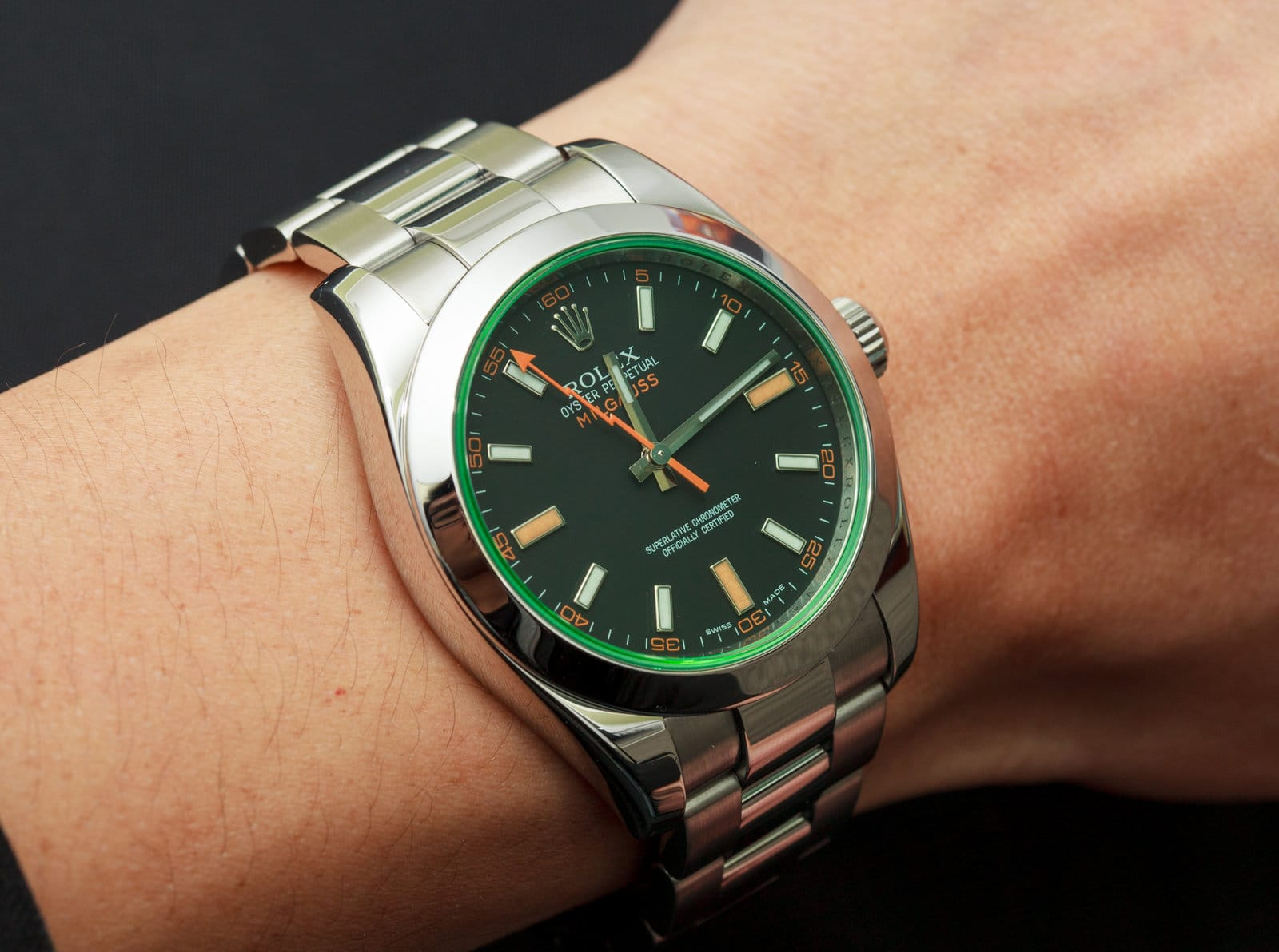 anniversary green crystal milgauss on wrist