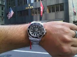 Man Wearing a Rolex Watch in Front of a Rolex Store in New York City