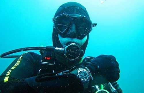 scuba diver wearing rolex watch