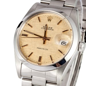Rolex Oyster Date 6694 Champagne Linen Dial