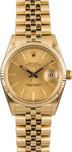 Pre-Owned Rolex Date 15037 Champagne Dial Gold Watch