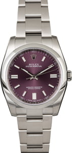 Unworn Rolex Oyster Perpetual 116000 Red Grape Dial