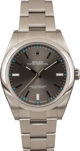 Used Rolex Oyster Perpetual 114300 Dark Rhodium w/ Blue Accents