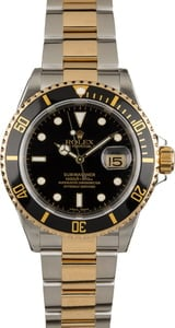 Used Rolex Submariner 16613 Black and Gold Bezel