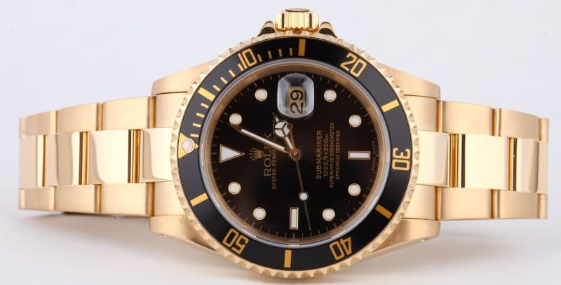 Gold Rolex Submariner 16618