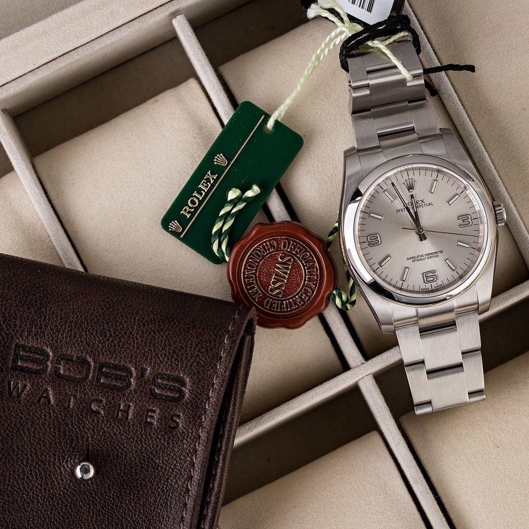 46727e191cc Unworn Rolex Oyster Perpetual 116000 Silver Arabic Dial