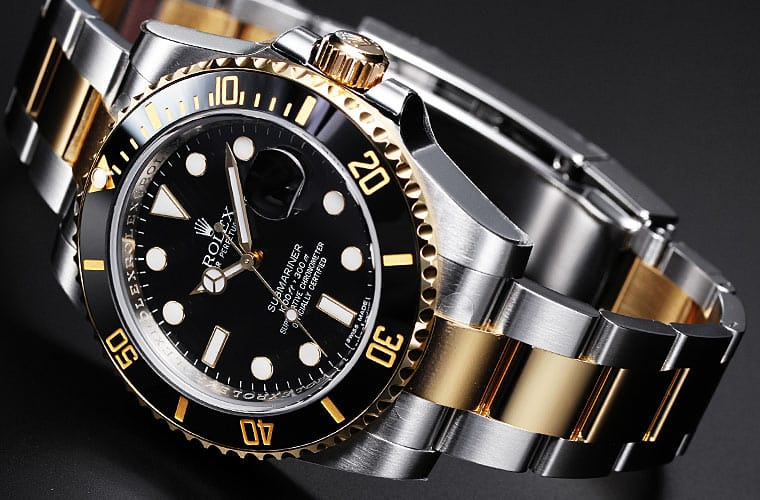 A Rolex Submariner 116613LN with a black dial and bezel