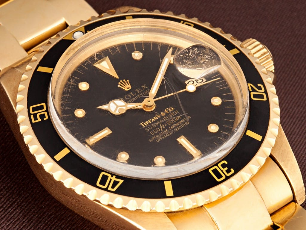 black dial gold rolex submariner tiffanys