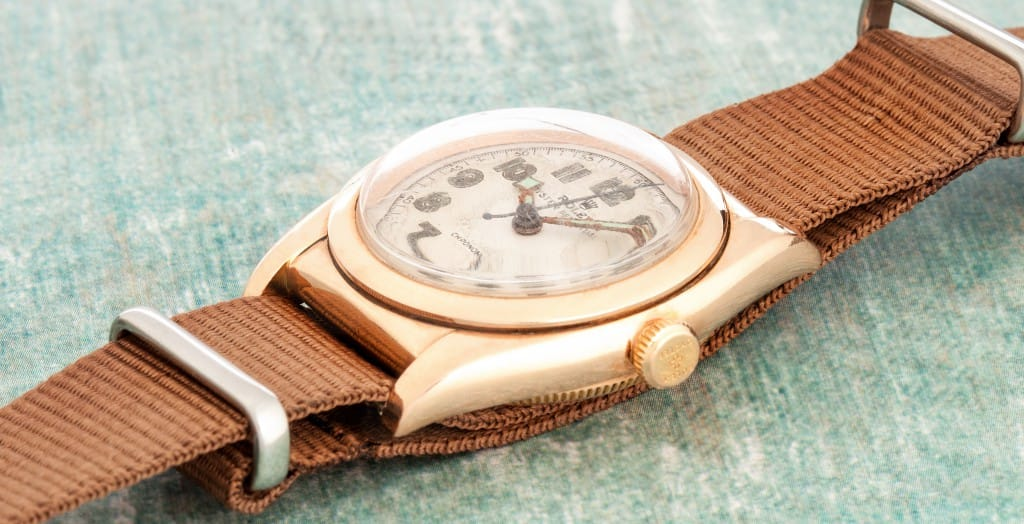 gold Rolex Bubbleback with leather strap bob's watches.