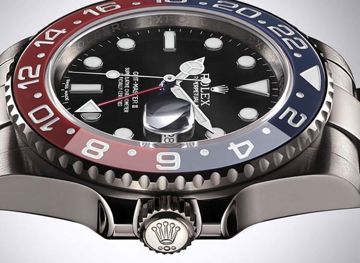 A Rolex GMT Master II with a red and blue bezel.