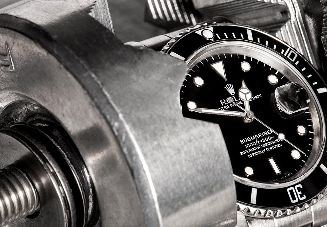 Rolex Submariner with Black Dial & Bezel from Bob's Watches.