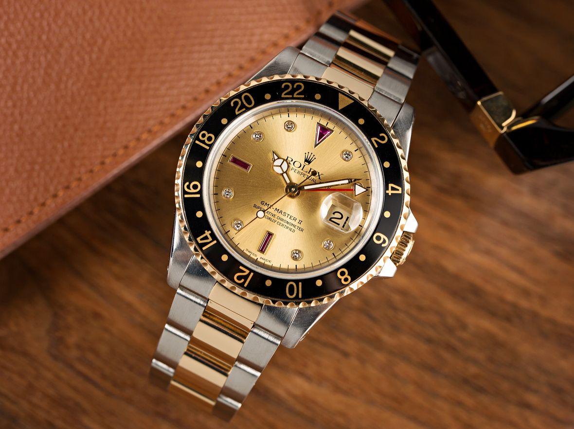 Rolex GMT-Master II Two-Tone 16713 Serti Dial Diamond Ruby