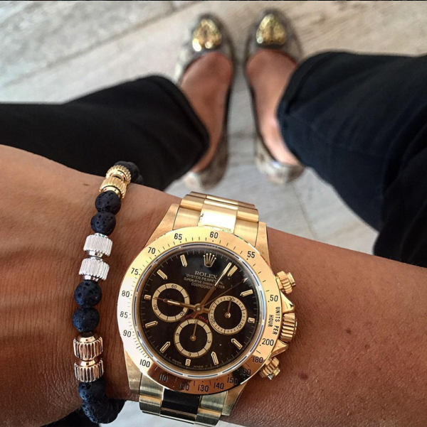 Gold Rolex Submariner On Wrist
