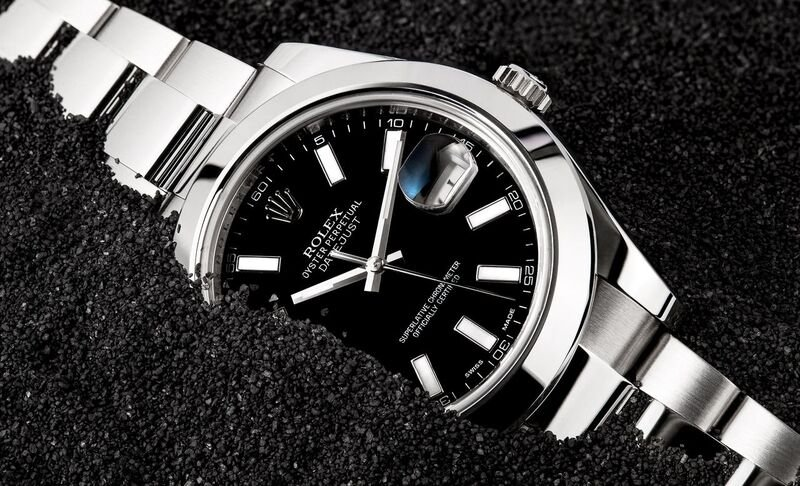 A Rolex Datejust II with a smooth bezel and a black dial.