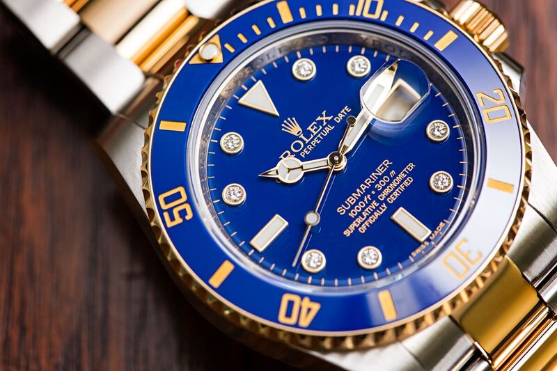 Rolex Submariner with diamonds ref 116613 two tone with blue dial.