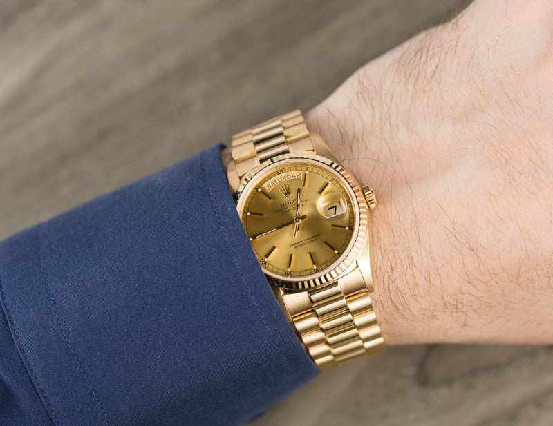 Yellow gold Rolex Day-Date President with fluted bezel