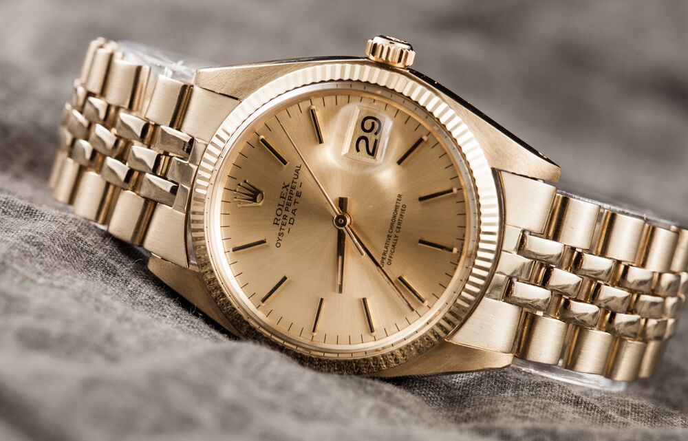 Yellow gold Rolex Date with fluted bezel and Jubilee bracelet.