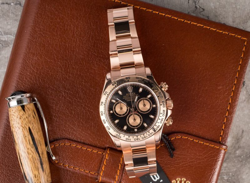 This Rose Gold Rolex Daytona with a black face blend.