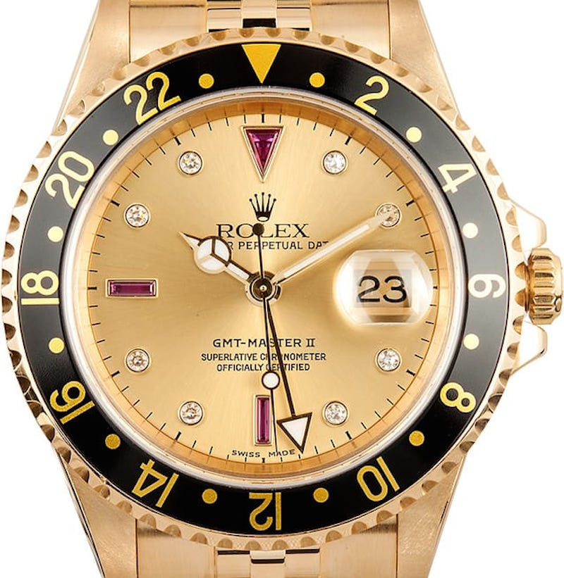 Rolex GMT-Master II ref. 16718 with black bezel and champagne Serti dial