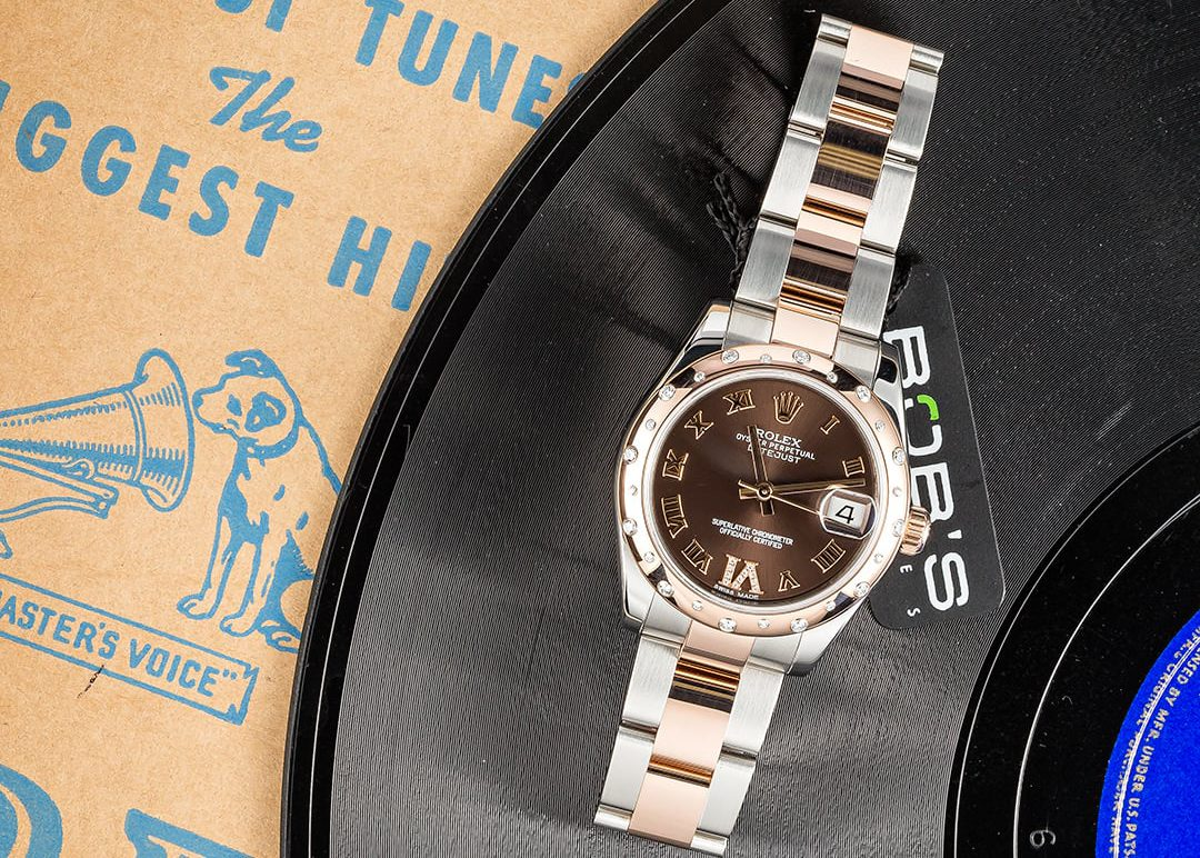 Role Datejust with Roman Numerals with a brown dial.