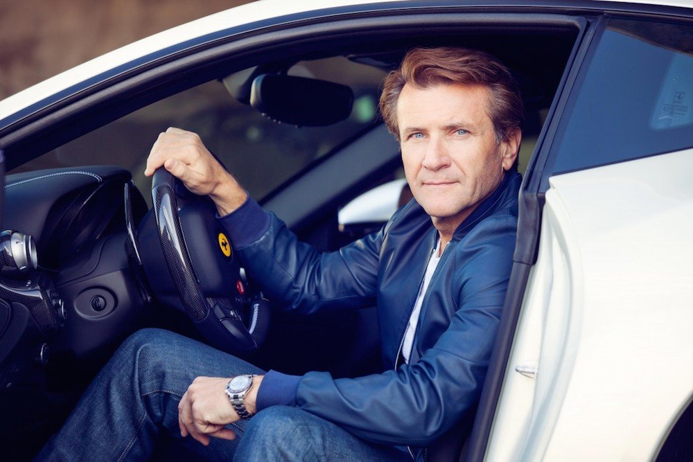 Robert Herjavec wearing his Rolex Daytona in platinum with a brown Cerachrom bezel