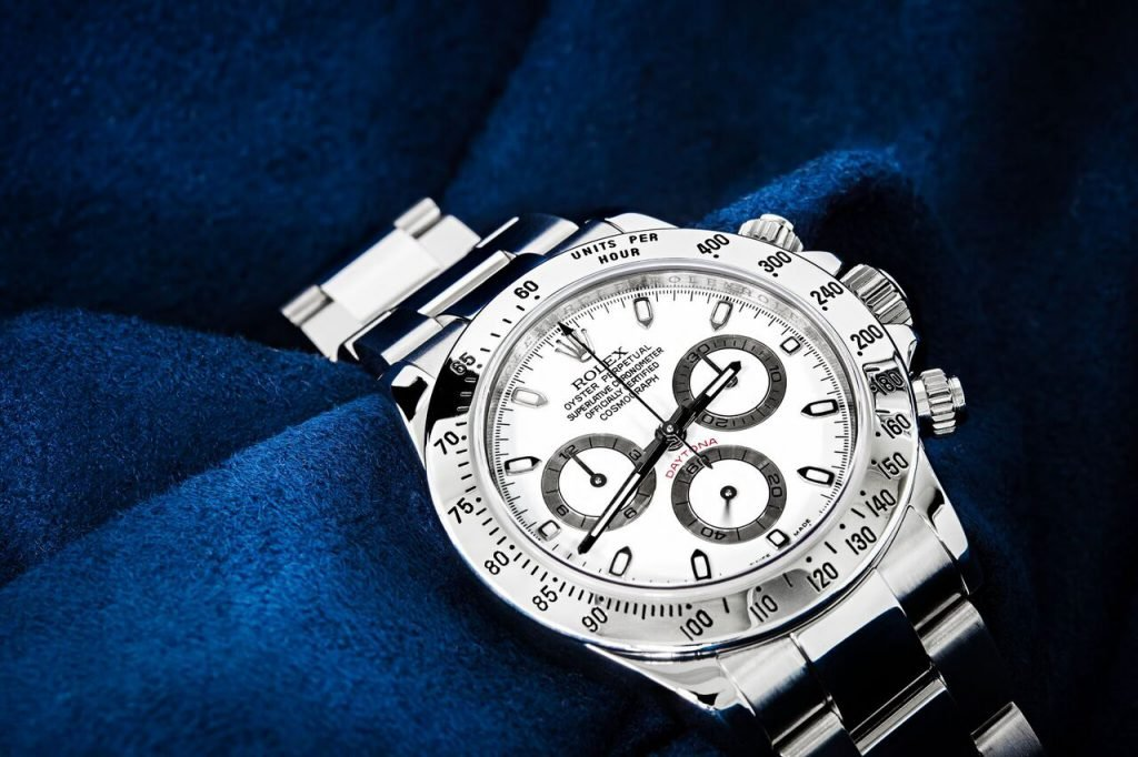 Stainless steel rolex daytona white dial can also be a ladies watch.