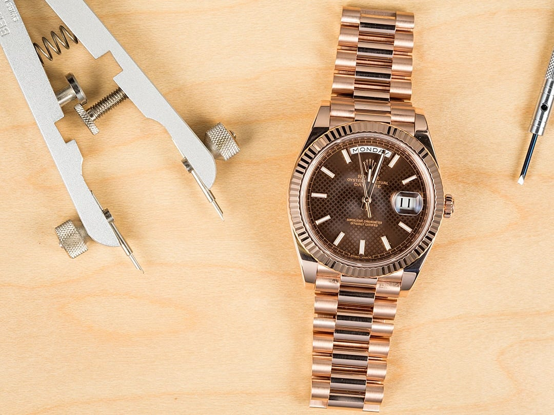 The Rolex Day-Date is can come in 18k rose gold with a fluted bezel.