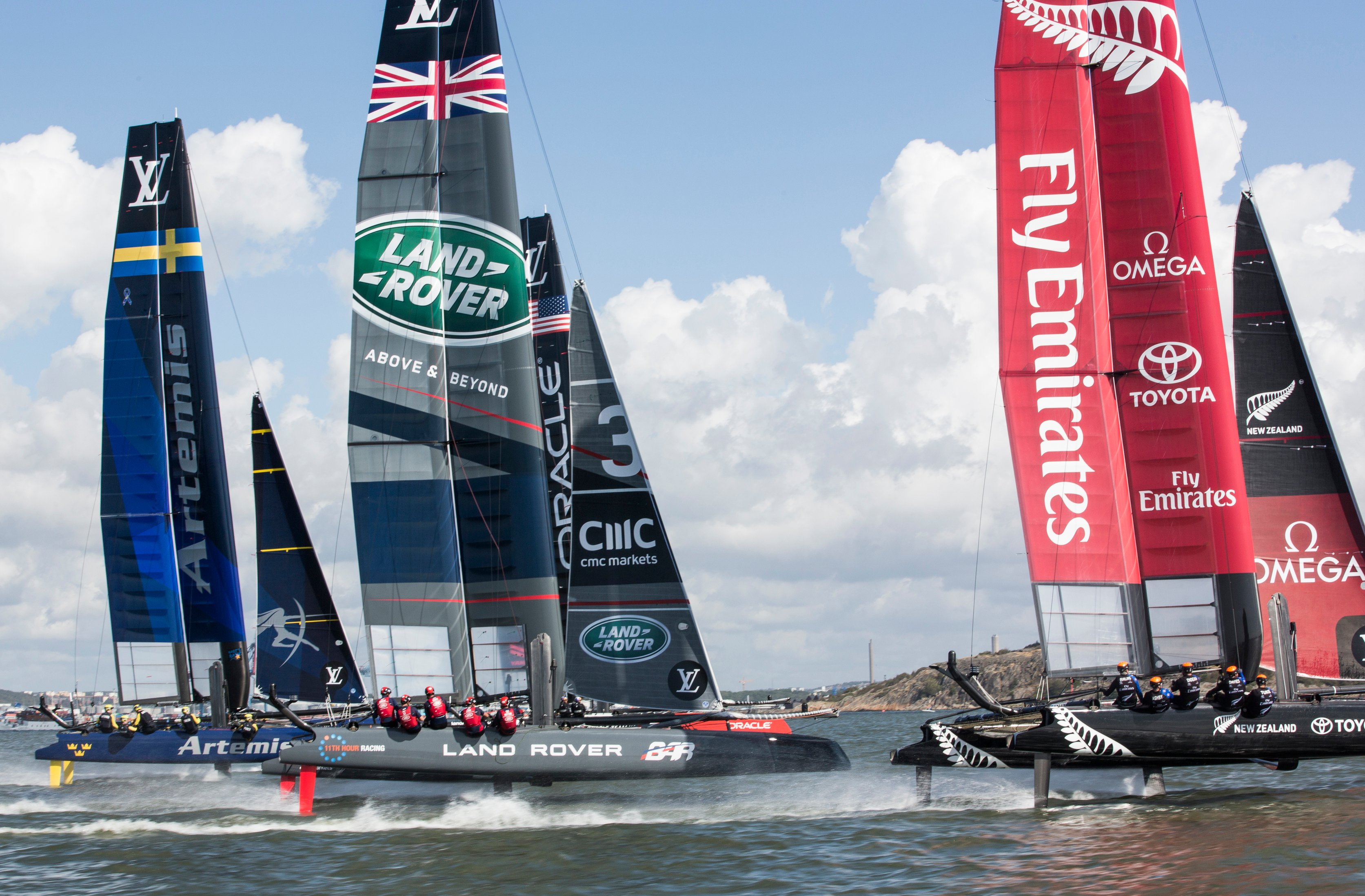 Land Rover, Omega, Fly Emirates, LV, and other various sponsors at the 35th America's Cup.