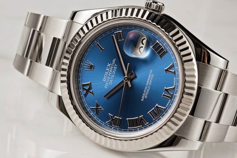 Rolex Datejust II ref. 11634 with a blue dial and fluted bezel.