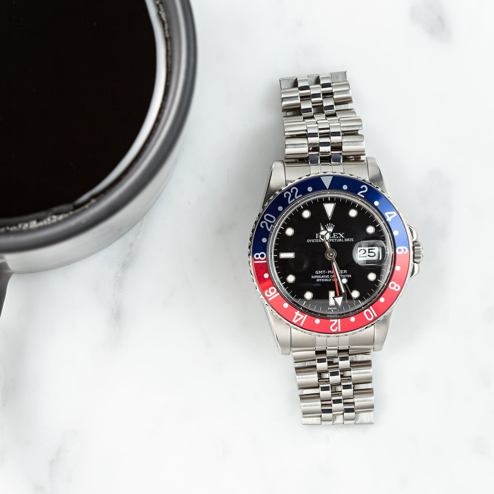 This Pepsi dial features a Blue and Red Bezel.