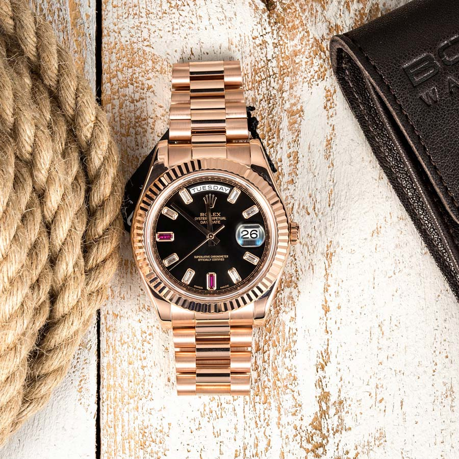 The gems on this Rose Gold Rolex President help clearly see the time.