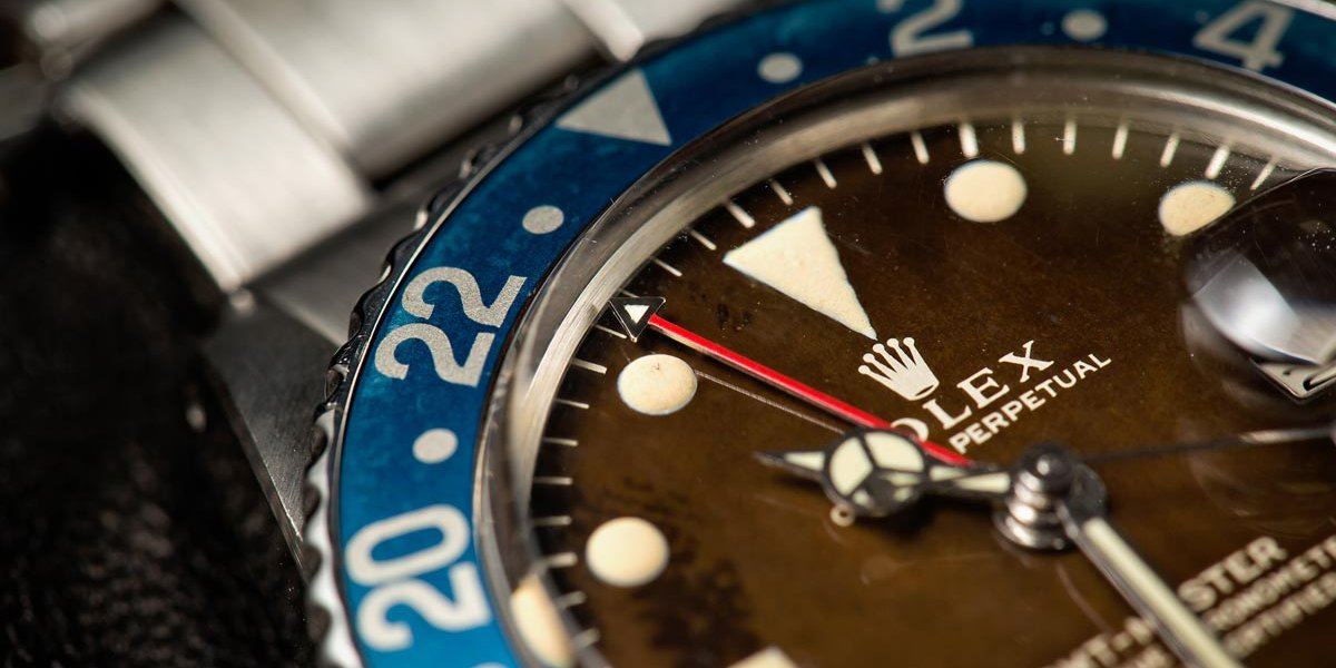 How Is a Rolex Price Determined for a Pre-Owned Watch? Vintage GMT-Master Tropical Dial Pepsi Bezel