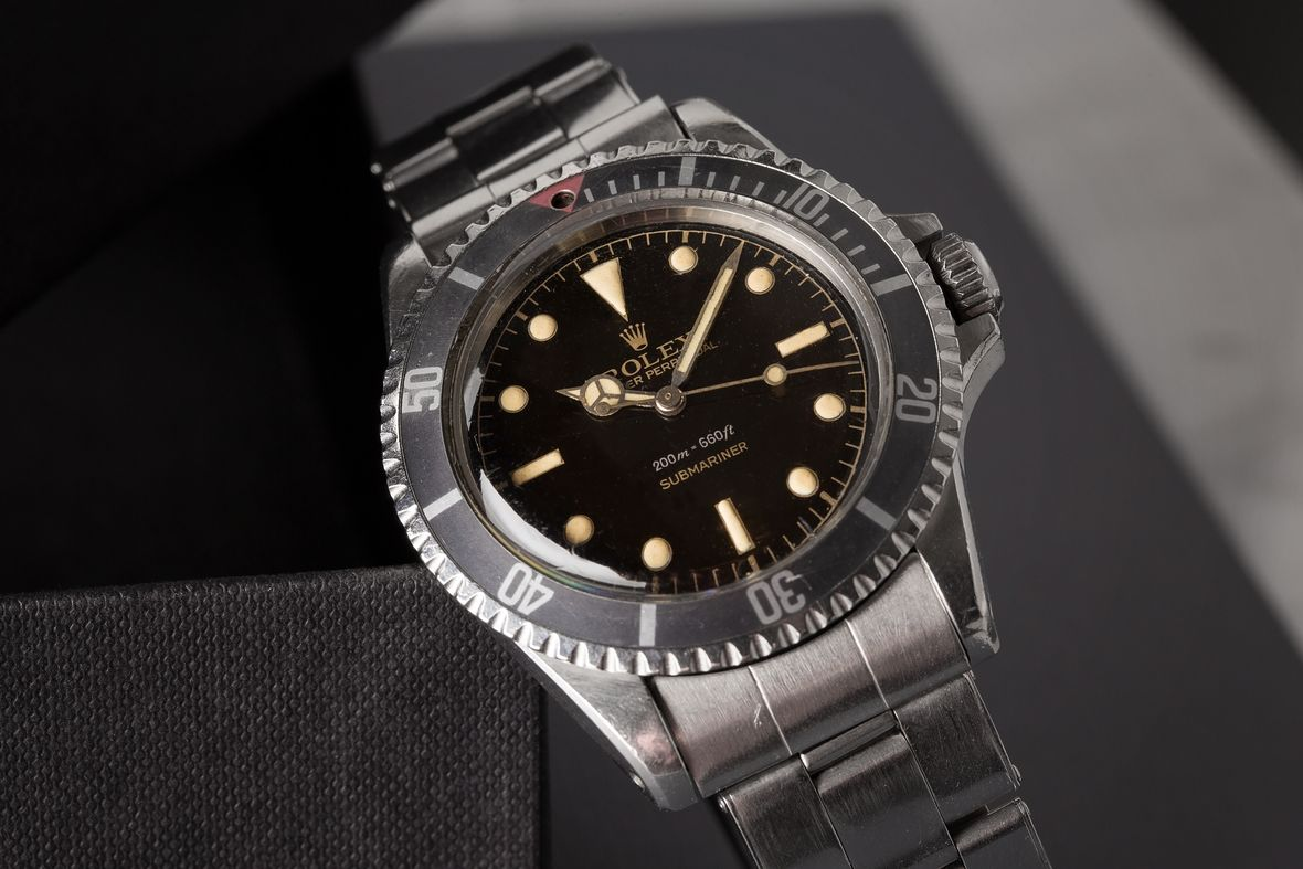 Vintage Rolex Submariner 5512 red triangle bezel insert chapter ring dial square crownguard
