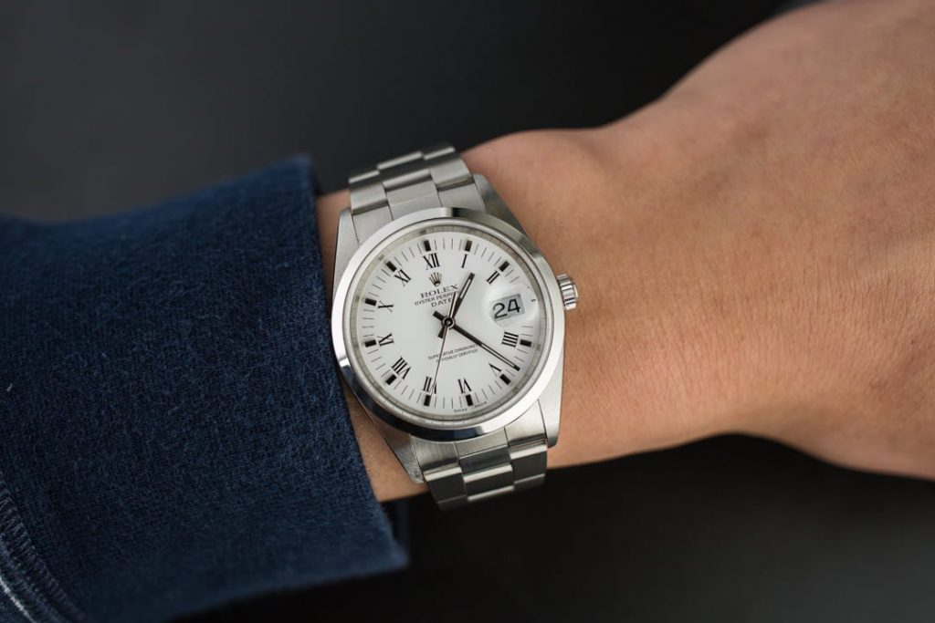 Small to mid-sized watches like the Rolex Date 15200 can compliment any outfit