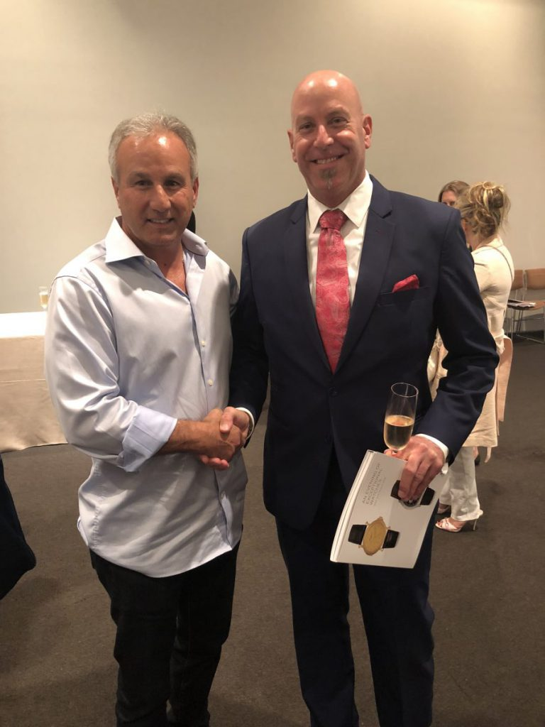 Paul Altieri, owner of Bob's Watches, meeting with the owner's son: Fletcher at Christie's