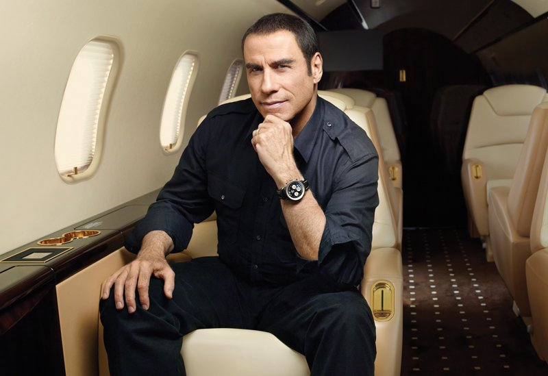 Travolta wearing a Navitimeter on his Challenger plane