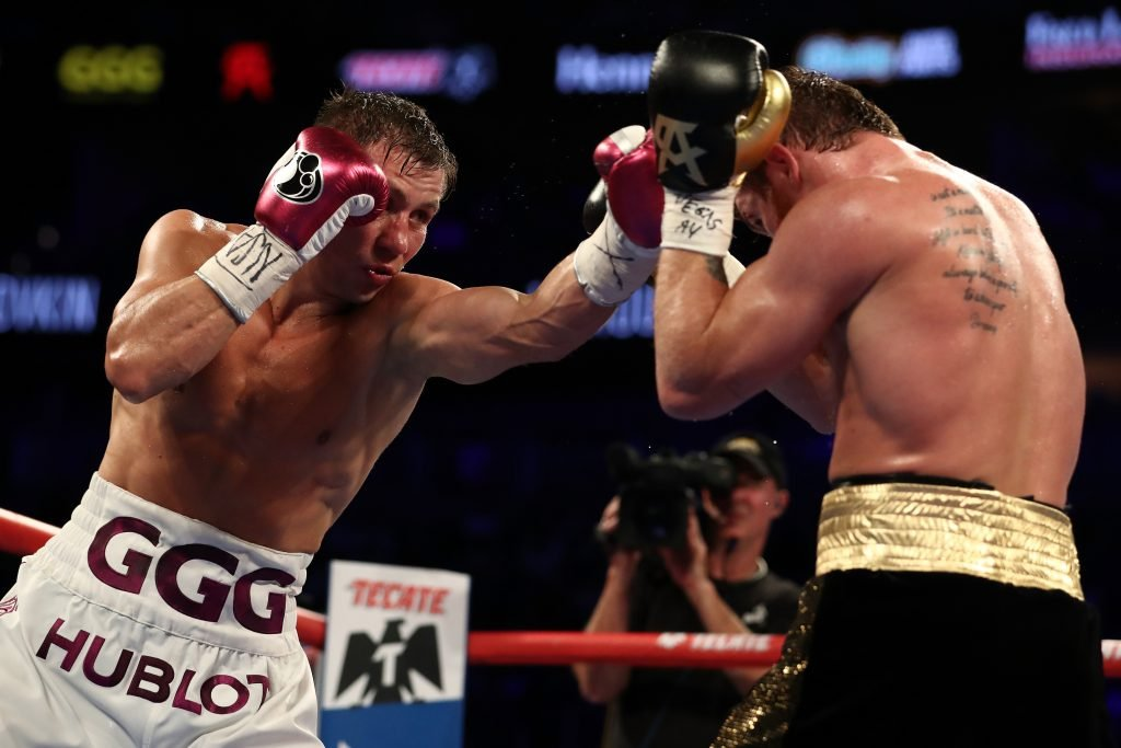Gennady Golovkin and Canelo Alvarez exchange punches during their WBC/WBA middleweight title fight at T-Mobile Arena on September 15, 2018 in Las Vegas, Nevada. (Photo by Al Bello/Getty Images)