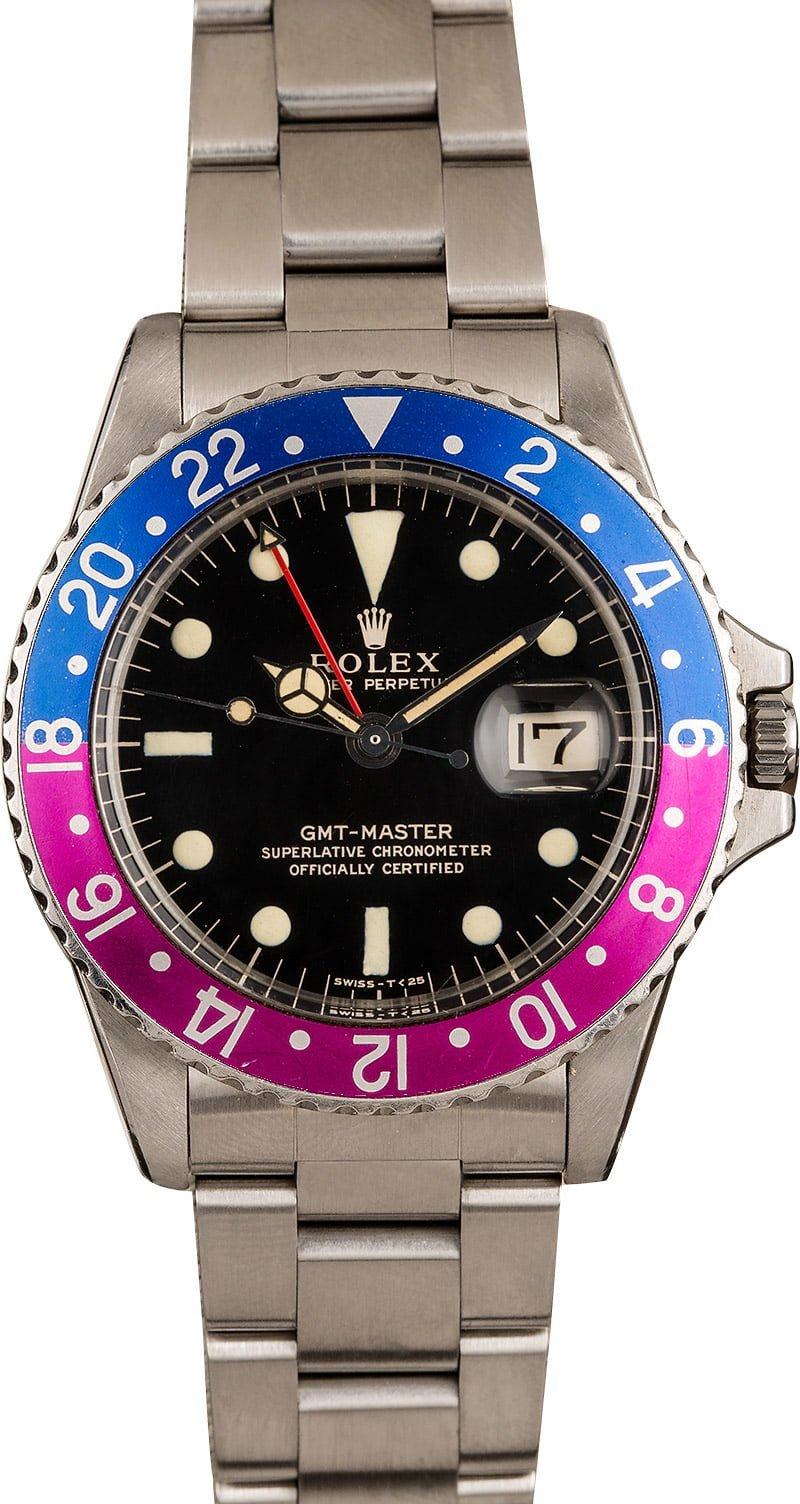 3 Favorite Vintage Rolex Watches We Love for April GMT-Master 1675 Gilt Dial Fuchsia Bezel