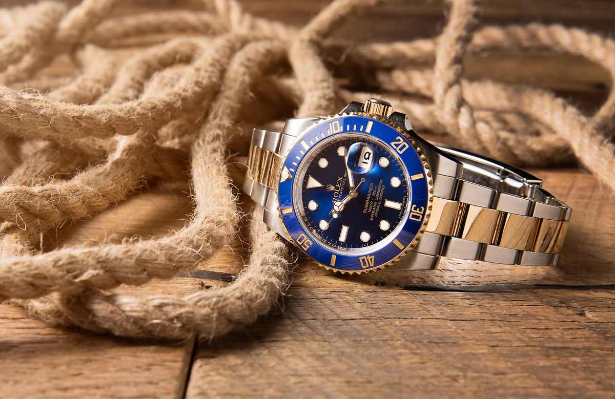 How Much Is a Rolex Submariner? Prices Guide 116613 blue steel and gold
