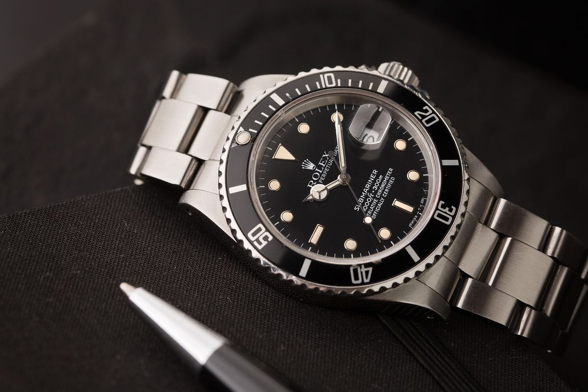 How Much Is a Rolex Submariner Prices Guide 16610 black tritium dial