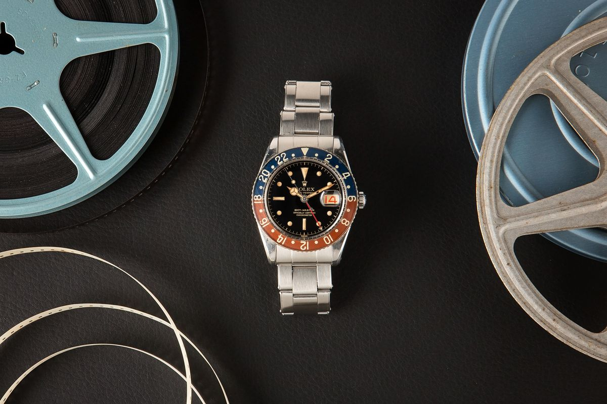 Luxury Watch Auction Iconic Watches Hollywood - Rolex GMT-Master 6542 Bakelite Pussy Galore