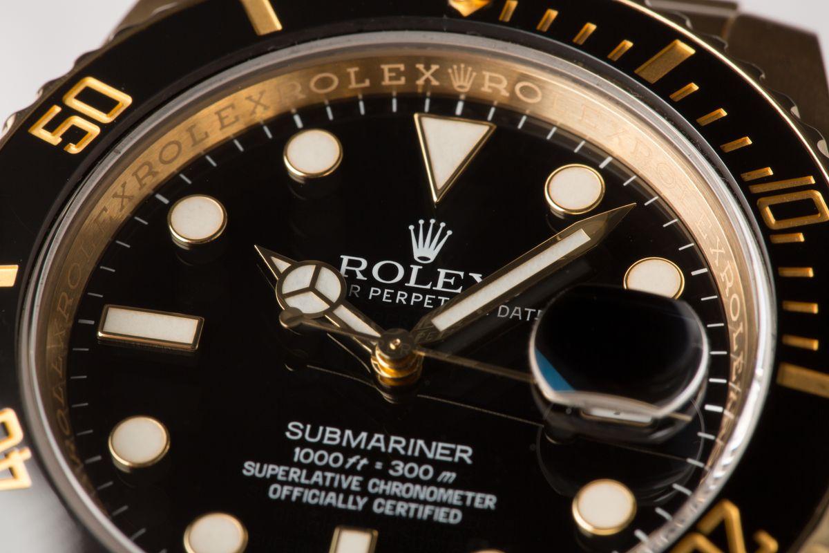 Gold Rolex Submariner Black Dial