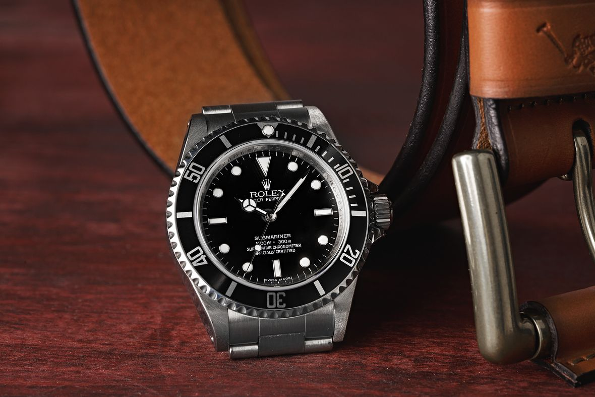 How to tell what Rolex Submariner series 114060M 4-line dial