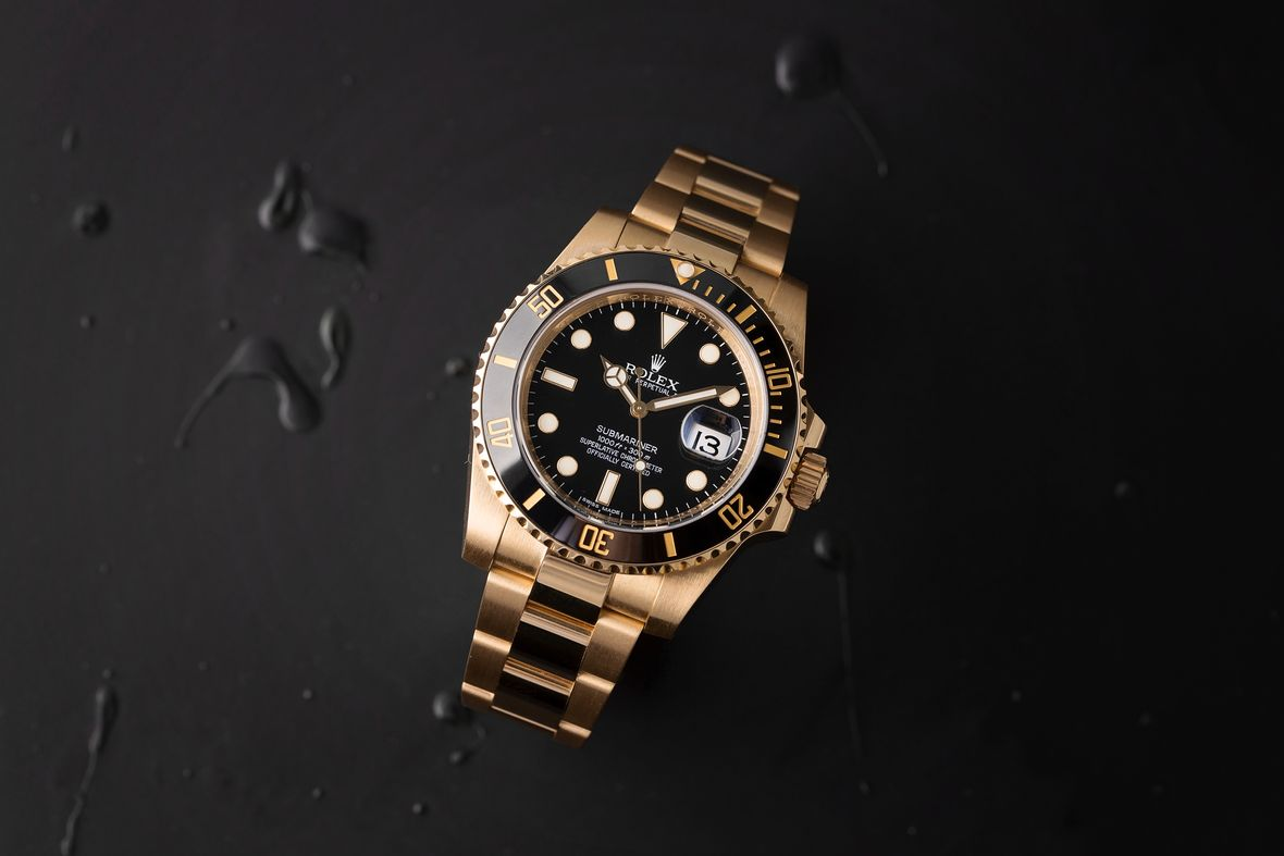How to tell what Rolex Submariner series gold black dial 116618LN ceramic bezel